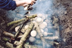 Experimental archaeology; firing neolithic style pottery in a clamp kiln.
