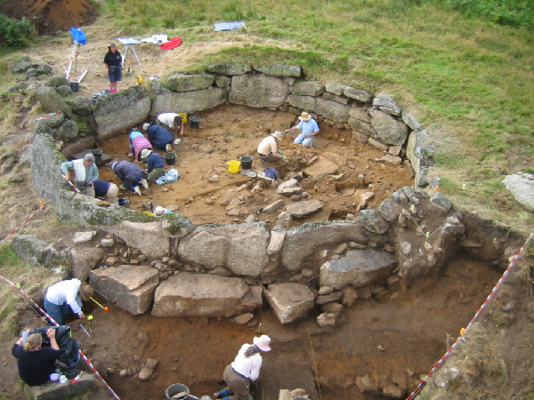 Excavating a roundhouse at Teigncombe, as part of the Archaeology and Bracken project.