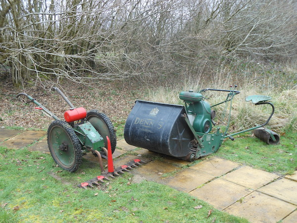 A selection of old lawnmowers
